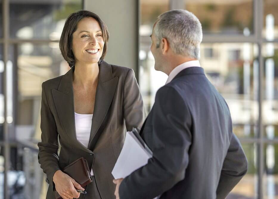 Woman and Man Discussing Business Proposal